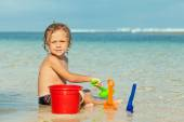 Little boy playing on the beach at the day time — Stock Photo
