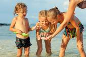 Happy children playing on the beach at the day time — Stock Photo