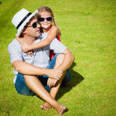 Father and daughter playing on the grass at the day time — Stock Photo