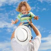 Father and son playing on the beach at the day time — Stock Photo