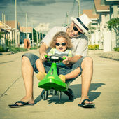 Father and son playing near a house at the day time — Foto Stock