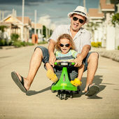 Father and son playing near a house at the day time — Stock Photo