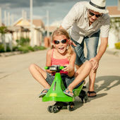 Father and little daughter playing near a house at the day time — Foto Stock