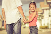Father and daughter playing near a house at the day time — Stock Photo