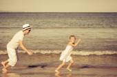 Father and daughter playing on the beach — Stock Photo