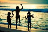 Happy children playing on the beach at the dawn time — Stock Photo