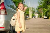 Happy schoolgirl standing on the road  — Foto de Stock