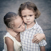 Portrait of sad teen girl and little boy — Stock Photo