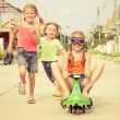 Happy children playing on the road at the day time — Stock Photo #53501027
