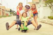 Father and children playing near a house at the day time — Stockfoto