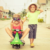 Happy children playing on the road at the day time — Stock Photo