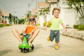 Two happy children playing on the road at the day time — Stock Photo