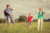 Happy family walking on the road at the day time. — Stock Photo