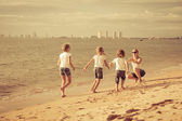 Happy family playing on the beach at the day time. — Stock Photo
