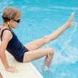 Little girl sitting near swimming pool — Stock Photo #53977591