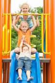 Three happy children on the playground  — Photo