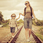 Happy family walking on the railway at the day time. — Stock Photo