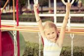 Happy little girl on the playground — Stock Photo