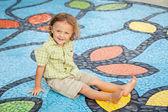 Happy little boy on the playground — Stock Photo