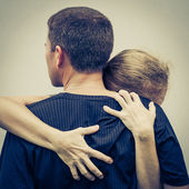 Sad woman hugging her husband — Foto de Stock