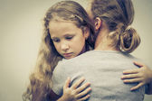 Portrait of one sad daughter hugging his mother  — Stock Photo