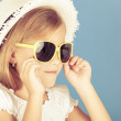 Fashion summer girl wearing a hat and posing for the camera — Stock Photo #55771231