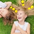 Happy little boy and girl lying on the grass — Stock Photo #55774095