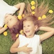Happy little boy and girl lying on the grass — Stock Photo #55774749