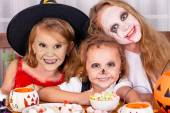 Happy brother and two sisters on  Halloween party — Stok fotoğraf