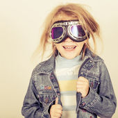 Portrait of a little girl in a denim jacket — Stockfoto