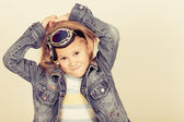 Portrait of a little girl in a denim jacket — Stock Photo