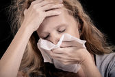 Portrait of a sick woman covering the face with a napkin — Stockfoto
