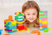 Little boy playing Lego on the floor — Stock Photo
