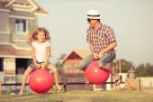 Father and daughter playing on the grass — Stock Photo