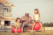 Father and kids playing on the grass — Stock Photo