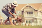 Father and son playing on the grass — Stock Photo