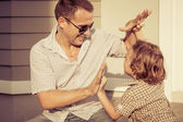 Dad and son playing near a house — Stock Photo
