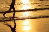 Happy girl running on the beach — Stock Photo
