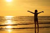 Happy girl standing on the beach — Stock Photo