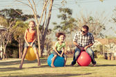 Dad and children playing on the lawn — Fotografia Stock
