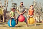Dad and children playing on the lawn — Stock Photo