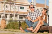 Father and daughter playing near the house at the day time. — Stock Photo