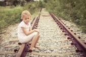 Portrait of sad blond little girl — Stock Photo