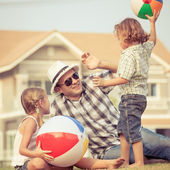 Happy family  playing on the lawn at the day time — Stock Photo