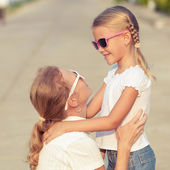 Mother and daughter standing on the road at the day time. — Stock Photo
