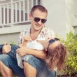Dad and son playing near a house at the day time. — Stock Photo #74528757