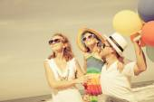 Happy family playing  with balloons on the beach at the day time — Stock Photo