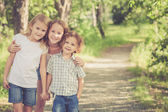 Portrait of happy children which standing in the park at the day — Stock Photo