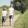Two happy children  playing on the road — Stock Photo #78982842