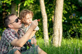 Father and son playing at the park at the day time. — Stock Photo